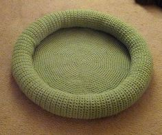 "This kitty bed is crocheted while holding two strands of yarn together at the same time so it's extra thick and plushy. The finished product measures 24"" wide and 3"" deep."