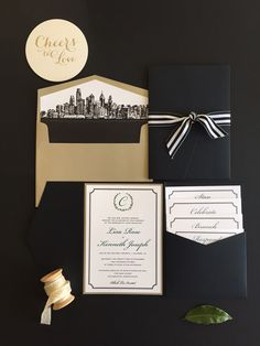 Classic black and white invitation suite with touches of emerald and gold. #blackandwhitewedding #classicinvitation #pocketenvelope #phillywedding