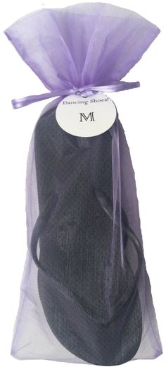 148ded7de29053 A soft lavender compliments these black bulk flip flops perfect for beach  wedding guests and receptions