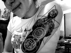 A dark and cool Hellblazer tattoo. Can you tell us who is the artist?