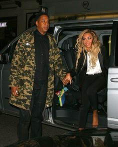 What a gentleman! Recent GRAMMY winner Jay Z gives his lady Beyoncé a hand before they hit up the Arts Club on March 5 in London
