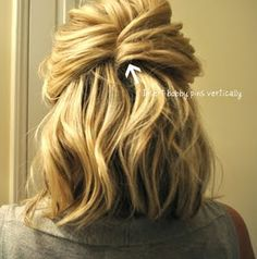 Simple half-up do. Start with curled hair. Pull a section from one side of your head back to the center & insert bobby pins vertically. Then grab a section from the opposite side, bring it back to the section, flip it around & insert pins (zig-zag side down) on the underneath section.