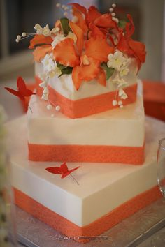 This cake is from an elegant orange and black garden wedding. The flower topping really gives it a tropical feel.