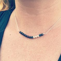 A personal favorite from my Etsy shop https://www.etsy.com/listing/461332438/brown-silver-bead-bar