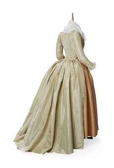 Striped silk taffeta open robe, probably French, c. 1790. The cream silk fabric is woven with a sky-blue and purple narrow stripe. The boned, low crossover bodice is lined in linen. The skirts are unlined.