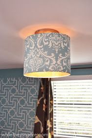 While They Snooze: Cover an Ugly Light Fixture with drum shade and fabric reupholstery Light Fixture Covers, Bathroom Light Fixtures, Light Covers, Ceiling Light Fixtures, Ceiling Lights, Light Fittings, Apartment Lighting, Concrete Candle Holders, Chandelier Lamp Shades