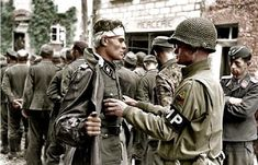 MP Lt. Paul Unger, 2nd Armoured Division, searching the POW SS-Untersturmführer Kurt Peters, III.Battalion/SS-Pz.Gren.Rgt. 37, 17.SS-Pz.Gren...