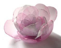 https://flic.kr/p/7mBU9b | SWEET PINK SILVER BIG ROSE BLOSSOM FLOWER BROOCH | SWEET PINK SILVER BIG ROSE BLOSSOM FLOWER BROOCH I get inspiration from natural beauty of romantic roses. Big flower is made with pink and silver grey organza tulles. In the center of the flower there are tiny silver and white colour beads. The brooch is sewn by hand. This is a very romantic brooch for brides, bridemaids, stylish feminine women and young girls. You will look fascinating and attractive with this…