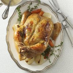 Rosemary-Orange Roasted Chicken Recipe from Taste of Home -- Guests will fall in love at first sight of this impressive citrus and savory herb roasted chicken! —Sarah Vasques, Milford, New Hampshire  #Christmas #dinner