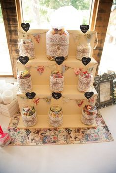 candy display with glass jars wrapped in lace and twine