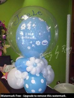 Cute take home piece.  Flowers from 260Q's and a balloon in a clear bubble balloon.