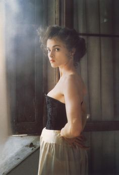The Wings of the Dove - Helena Bonham Carter as Kate Croy, wearing a black corset and white petticoat.