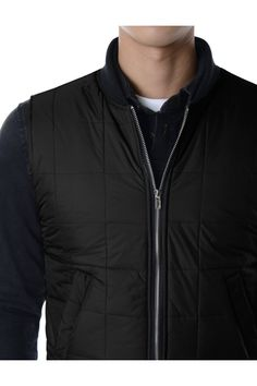 Winter puffer vests for men. Winter stylish padded waistcoats with zipper front closure, everyday sleeveless clothing by Korea. Lightweight, warm puffer vests.