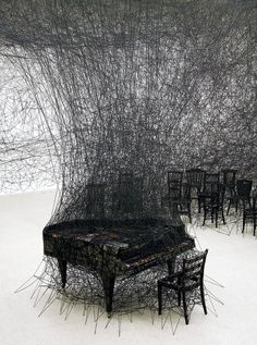 In Silence (2009). By the Japanese installation artist Chiharu Shiota