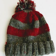 I created this hat as a quick knit to create a warm dense hat for my sons to wear ice fishing or to keep my husband's bare head warm on his winter dog walks. Free pattern