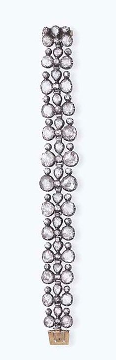 A GEORGIAN DIAMOND BRACELET   The openwork foiled-back panel, designed as two rows of graduated rose- cut diamonds, accented by old European-cut diamonds, joined by rose-cut diamond links, mounted in silver-topped gold, circa mid-to-late 18th century, (clasp possibly of a later addition), 7 ins.