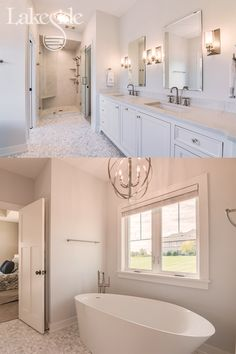 This serene white master bathroom features a tiled walk-in shower, large soaking tub, silver light fixtures and large windows. Shower Light Fixture, Shower Fixtures, Bathroom Light Fixtures, Modern Light Fixtures, White Master Bathroom, White Bathroom Cabinets, Bathroom Windows, Modern Bathroom, Window In Shower
