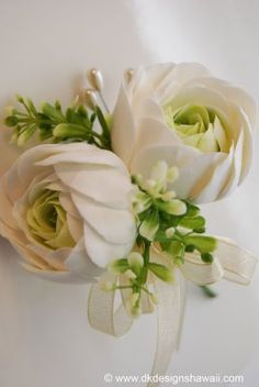 corsage idea-could use ranunculus in boutonnieres, too, and in bouquet to tie all together.