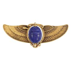 Egyptian Revival Scarab BroochLate 19th Century, French. Gold and lapis lazuli.
