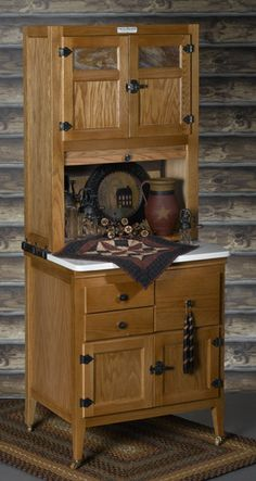 hoosier  ........ almost  every farm house had a hoosier cabinet....most were hand made  back in the day.......