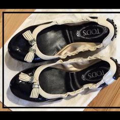 Two-toned Tod's Ballet Flats Size 8 Beautiful Black and Cream Patent Ballet Flats. Size 8. Would fit 7.5 to small size 8. Barely worn. Excellent condition Tod's Shoes Flats & Loafers