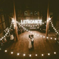 Let's Dance. this beautiful barn like wedding with the twinkling lights is adorable.