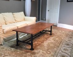 100% authentic reclaimed solid wood & iron pipe coffee table