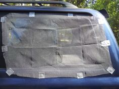 Picture of Attach Rare Earth Magnets to Edge of Window Screen Using Duct Tape. Screen Can Be Folded and Kept in Glove Compartment.