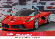 MARANELLO, ITALY - APRIL 30, 2014 Ferrari LaFerrari in a Ferrari factory showroom Ferrari LaFerrari is one of the most expensive models avaliable by Ferrari - Shutterstock