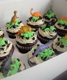 Are you ready now to prepare these extraordinary Jurassic World Inspired Cakes to your kids? These are mini dinosaur figures on chocolate cupcakes with white icing, oreo crumbs and green grass made of icing. Could be a moderately easy party DIY Dinosaur Cupcakes, Dino Cake, Dinosaur Birthday Cakes, Boy Birthday Cupcakes, Dinosaur Cake Easy, Boys Cupcakes, Volcano Cupcakes, Dinosaur Cakes For Boys, Dinosaur Dinosaur