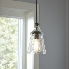 With a style inspired by the industrial revolution, the Sargent Mini Pendant brings true mood lighting to your space. Seeded glass provides an antiqued look that complements the bronze hardware and shaped canopy.