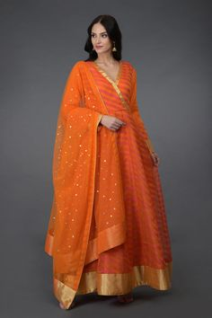 This is an orange pure kora silk Banarasi zari handwoven anarkali suit. The kalidaar shirt has resham striped all over and gold zari weave borders on front neckline, hemline and sleeve ends. Sarara Dress, Dress Cuts, Orange Suit, Orange Dress, Red Suit, Indian Dresses, Indian Outfits, Indian Attire, Pakistani Dresses