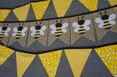 Ready to Ship in just a few days!!  Buy the individual banners separately or as a 2-banner set!  This honey bee banner set includes a burlap banner with seven fabric appliqué bees, and a second bunting banner made from yellow bee fabrics on black trim. Use these pieces as a photo backdrop for a first birthday, or decorate at a birthday party by hanging the bees on the food table and the bunting around the party area, decorate a nursery or for any summer party.  This banner set would also be…