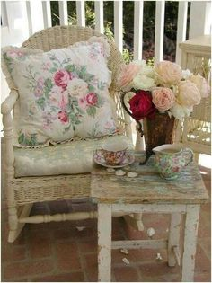 English country. Love the prints, the living flowers, and the brick patio.