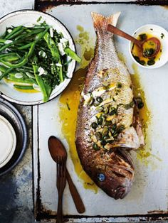 Snapper with white wine, green olives and parsley (dentice alla vernaccia).