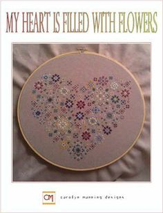 My Heart Is Filled With Flowers is the title of this cross stitch pattern from CM Designs..