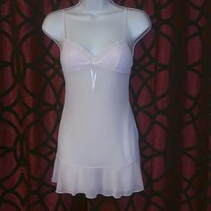 Light pink Victoria's Secret lingerie Light pink Victoria's Secret lingerie with a little white bow around the bust area body is a mesh type fabric it's see through like new Victoria's Secret Intimates & Sleepwear Shapewear