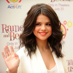 Selena Gomez Wavy Hair! Want this but a little shorter, I'm doing locks of love this summer again, can't wait!(: