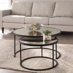 Mercer41 Round up style points with this set of nesting coffee tables. Clean black frames support sleek antique mirrored tabletops, opening up small spaces. Place side-by-side for a spacious cocktail table look, or stack up for a tidy living space or media room.