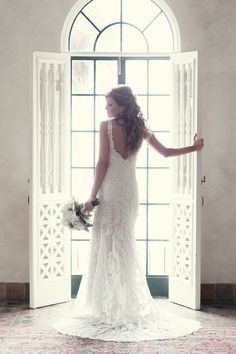 love this lace gown with a deep V back...