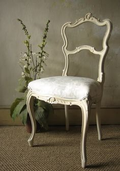love this french rococo salon chair  white w/black leather cover or blk/wht print?