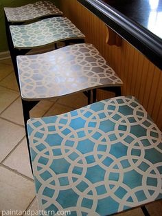 I can do something like this to the white ones I just got. Make them look a little less modern. Stenciled Bar Stools   Before and After