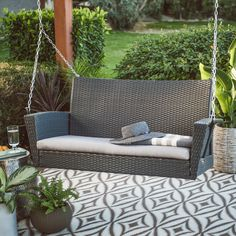 Coral Coast Soho Wicker Porch Swing with Free Cushion | from hayneedle.com
