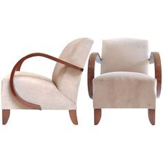Pair of French Art Deco Walnut Armchairs  France  circa 1940s  French Art Deco period pair of armchairs in French shellac walnut with new velvet blend upholstery. Very comfortable with plush seats and back. We love the look and feel of the curved, classically Art Deco arms. Seat height is 17.25 in.