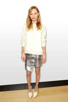 Kate is an avid wearer of the sweater + skirt combo. To keep the style interesting she plays with textures, prints and trends like the metallic skirt.
