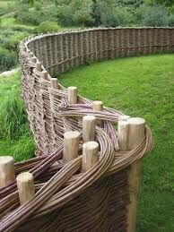 woven fence. WOW. The time, the amount of willow...Just doing a small one tooks me all day!