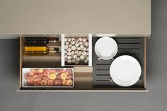 The bulthaup b3 interior prism system is so versatile and not just for cutlery. Add in plate plinths and storage containers with small rubber legs that fit snugly on top of the corrugated prism, to maximise the usable space. The prism is also perfect for storing bottles of olive oil, vinegar and cooking wine.