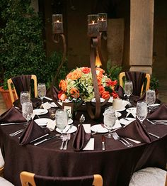 simple display of an urn & scroll candlesticks