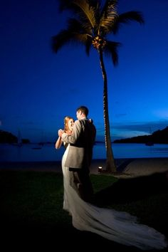 Beach weddings are always romantic-- how lovely is this moment for the newlyweds?! {Photo: The Westin St. John Resort & Villas}