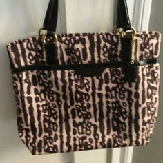 Authentic Coach Tote Leopard design New,  never been used,  medium size tote from Coach.  Unique pattern for this year done in canvas with solid brown interior. One large outside pocket and several smaller pockets inside including a zippered pocket for private essentials. I bought off Tumble deal and is larger than what I wanted. Coach Bags Totes